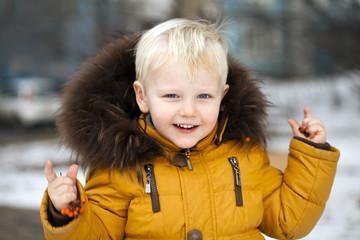 Close up portrait, little boy in a winter park