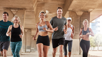 Adults exercising with running club group