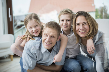 Germany, Munich, Happy family with two kids at home