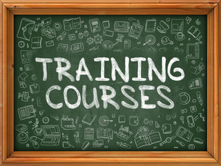 Training Courses - Hand Drawn on Green Chalkboard with Doodle Icons Around. Modern Illustration with Doodle Design Style.