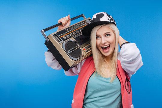 Woman holding retro boom box