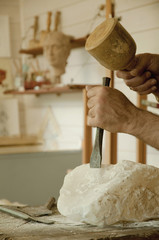 Sculptor carving soapstone