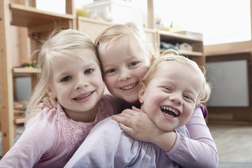 Three little girls, best friends, in kindergarten