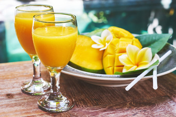 Glasses of fresh tropical smoothie or mango juice