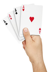 Hand holding four aces semi-overlapped winning hand poker isolated