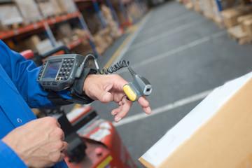 Scanning parcel in warehouse with finger scanner
