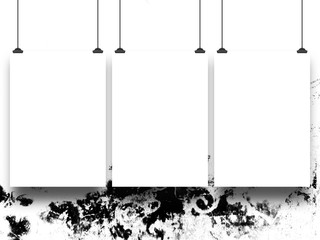 Close-up of three blank frames hanged by clips against black and white abstract background