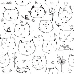 Seamless texture made with ink cats faces, drawn freehand