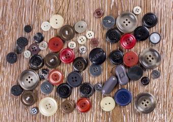 Various sewing button on wooden table