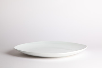 White empty plate on white background