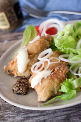 Fried cod and salad