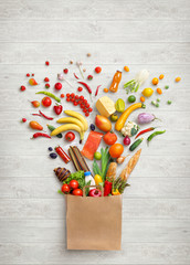 Healthy food in package. Studio photography of different fruits and vegetables on white wooden background, top view. High resolution product.