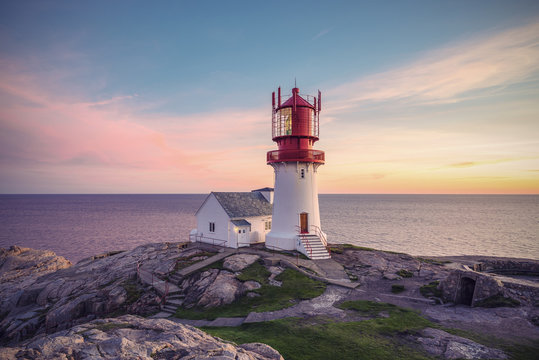 Lighthouse Lindesnes Fyr at evening on most southern point of Norway, Europe, Vintage filtered style