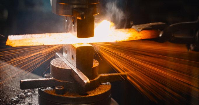 Locksmith working hot iron.