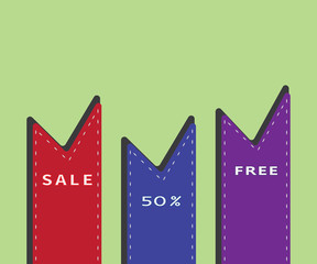 Bookmarks of different colors on green background