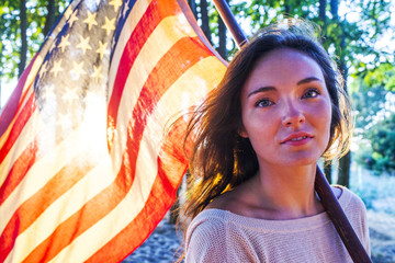 Caucasian woman holding American flag