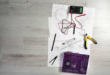 Project drawing and digital multimeter top view