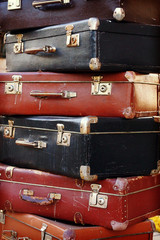 Pile of colorful vintage suitcases