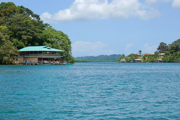 Canal Loma Partida in the archipelago of Bocas del Toro with a restaurant over the water on the left side, Panama, Caribbean sea, Central America