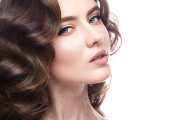 Portrait of beautiful girl with a gentle makeup, curls and crystals on the body. beauty face.