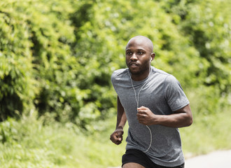 Black man running in park