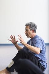 Caucasian teacher gesturing in acting class
