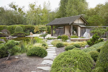 Wooden building and stepping stones in zen garden
