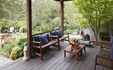 Wooden furniture on garden patio