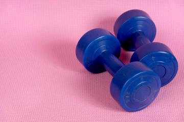 blue dumbells on the pink