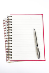 pen over note book on white background