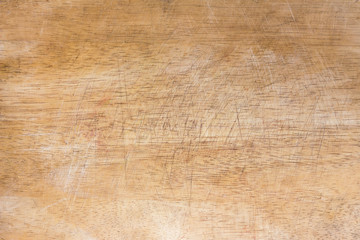 closeup of a worn wooden cutting board background