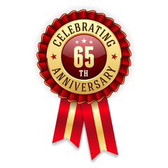 Gold 65th anniversary badge, rosette with red ribbon on white background