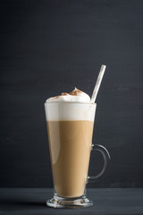 Spoed Foto op Canvas Milkshake Coffee in glass on the wooden background