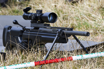 Military sniper aims at a target