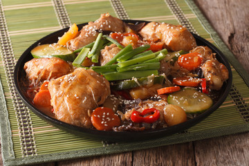 Korean cuisine Dakjim: chicken with vegetables and sesame close-up