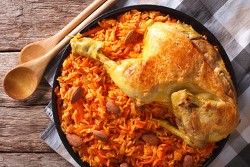 Arabic Food Kabsa: chicken with rice and vegetables close-up. horizontal top view
