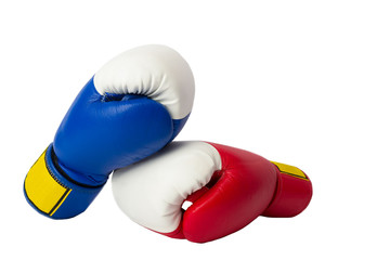 A pair of boxing gloves on white