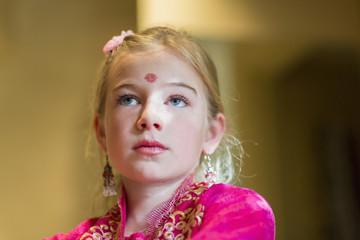 Caucasian girl wearing bindi on forehead