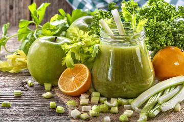 fresh homemade green smoothie made from celery, on rustic table