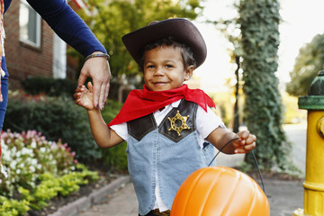 Mother with son dressed as cowboy for Halloween