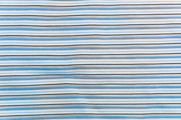 background, texture of a knitted fabric with white, gray, blue, black stripes