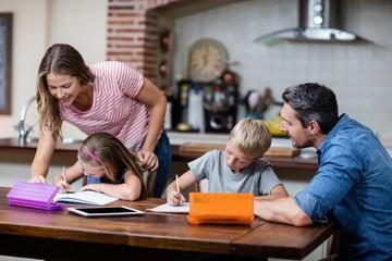 Fototapeta Parents helping the kids with their homework obraz