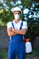 Portrait of confident pesticide worker with crossed arms