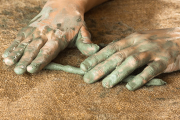 hands of women working with clay, closeup