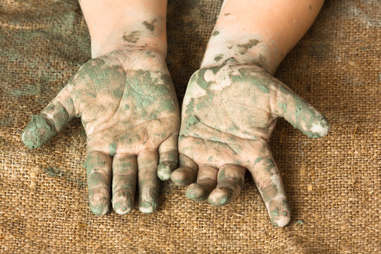 hands of child after working with clay