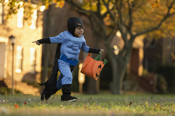 African American boy trick-or-treating on Halloween
