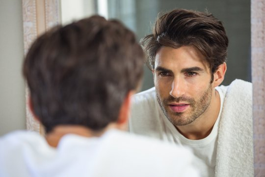 Man looking himself in mirror