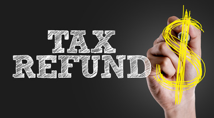 Hand writing the text: Tax Refund