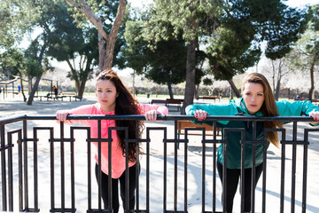 Two Girls hard working out in a Park