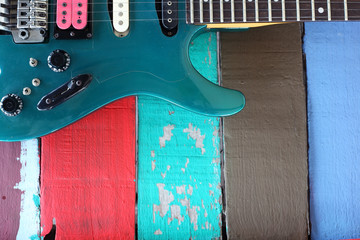 colorful guitar and background.